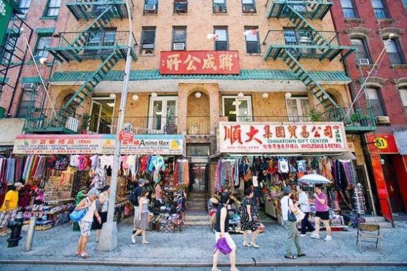 Stores and pedestrians in Chinatown, New York City.