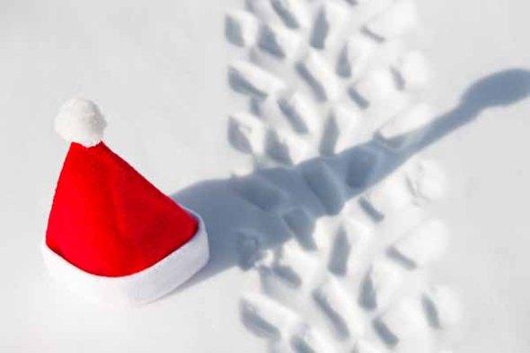 A Santa hat on a frozen lake.