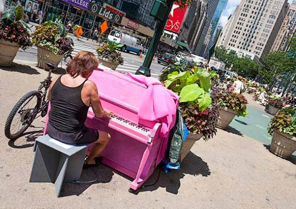 A piano player in Herald Square in New York City.