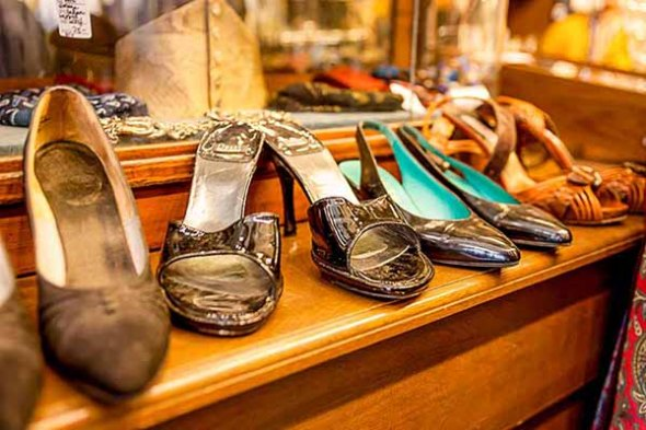 Ladies shoes on display in a thrift shop.